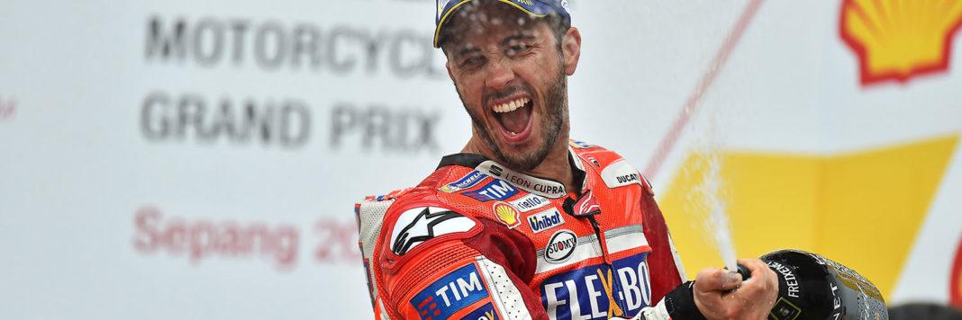 Grinta, determinazione e anche un pizzico di fortuna permettono ad Andrea Dovizioso di festeggiare sul primo gradino del podio
